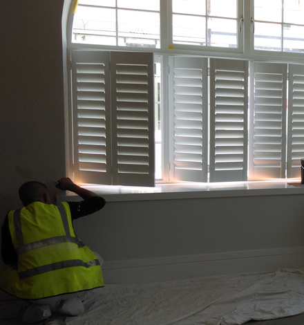 fitted wooden shutters